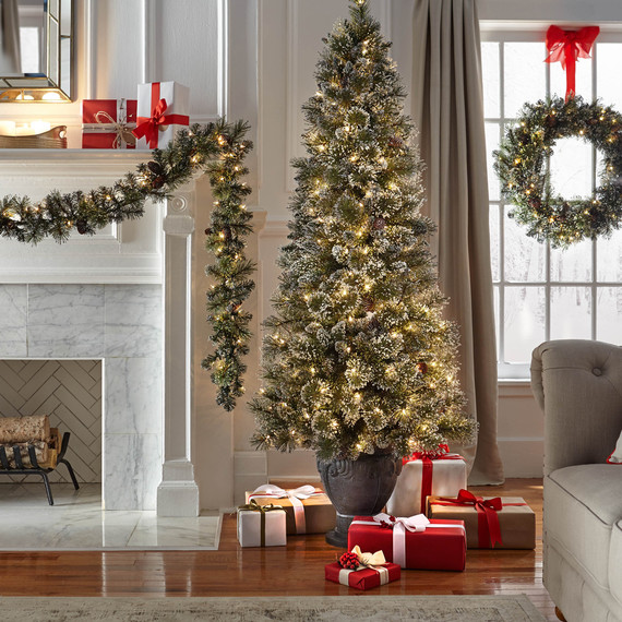 living room decorated with holiday greenery