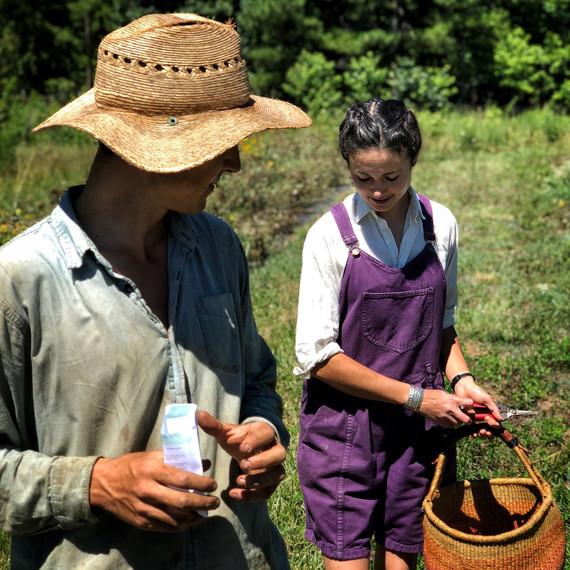 vera holding basket gordon wearing hat in field