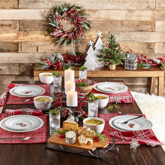red plaid table setting with holiday illustrated plates