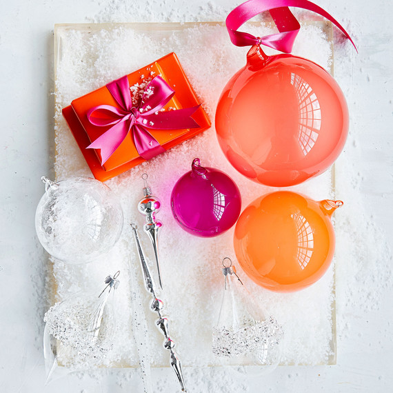 handblown glass orange and pink ornaments in box with faux snow