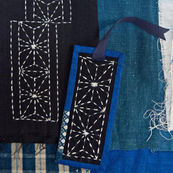 a blue bookmark with sashiko stitching