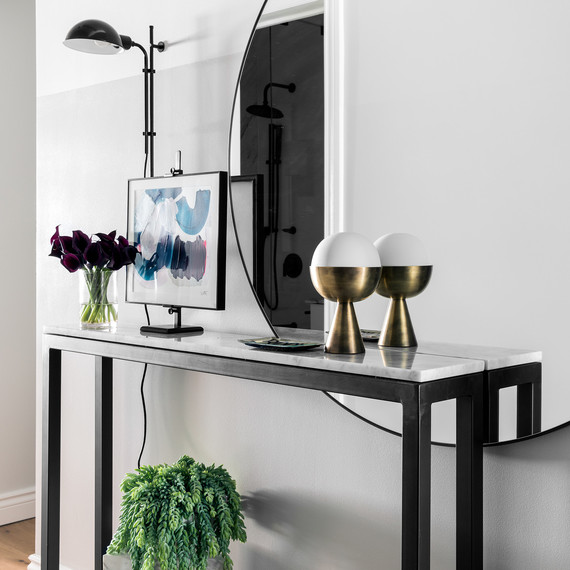 marble table and large round mirror