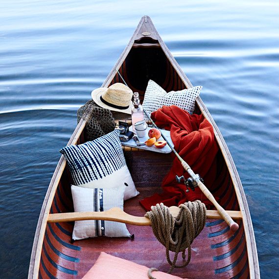 canoe with pillows fishing rod