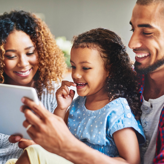 happy family looking at tablet