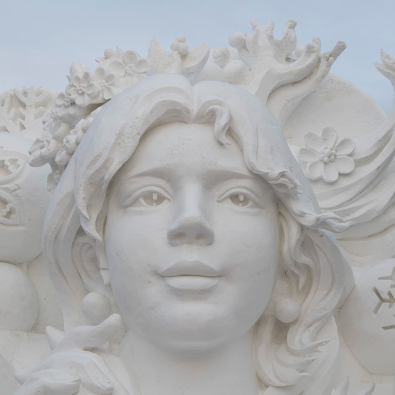 Girl and snowflake snow ice sculpture