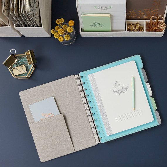 linen notebooks on navy desk