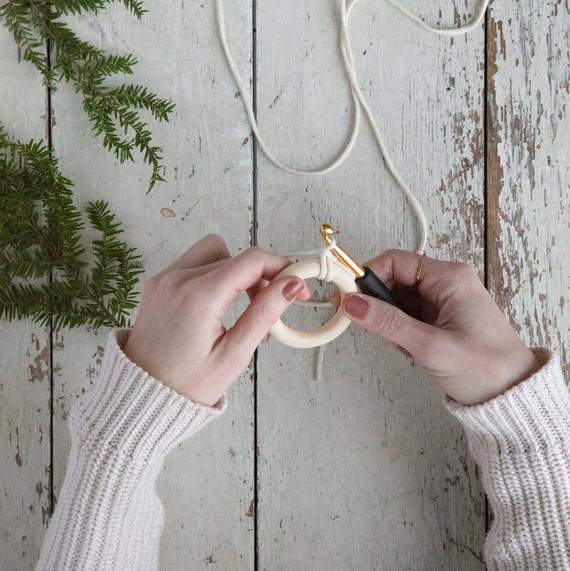 working yard around wooden wring crochet wreath