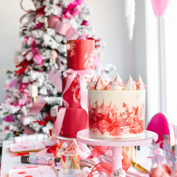 nutcracker christmas party pink red table setting with cakes