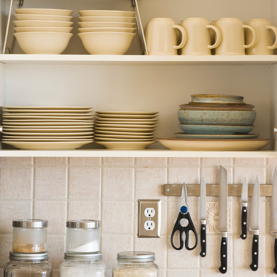 organized dishes cabinet and counter in kitchen