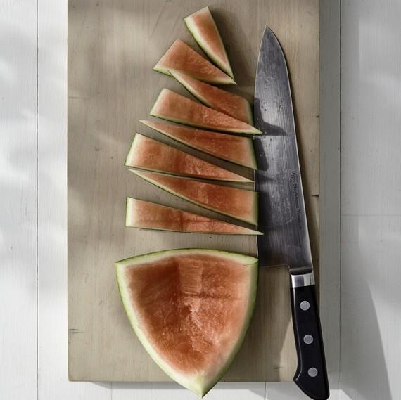 cutting up watermelon rind