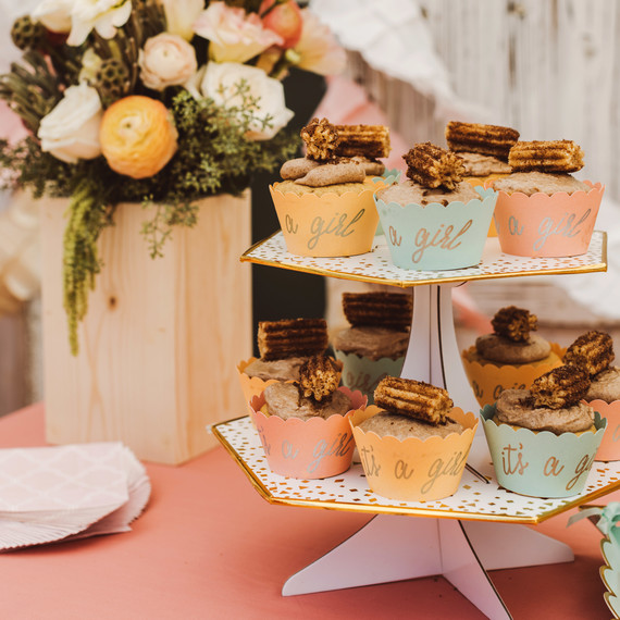 mint blush baby shower cupcakes on display