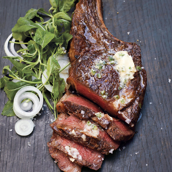 rib eye with jalapeno butter on a wooden surface
