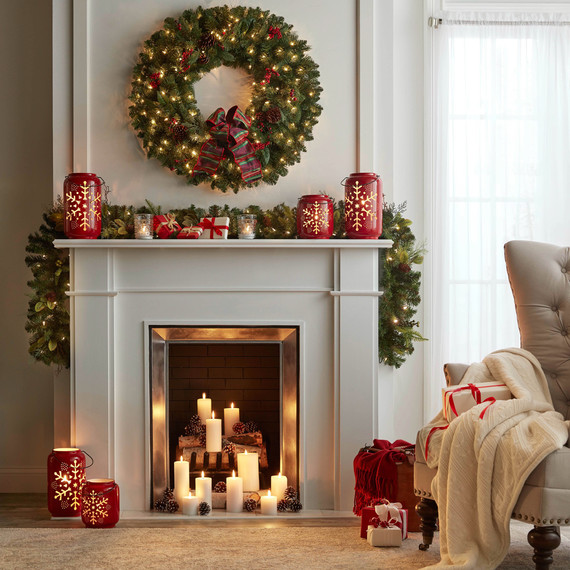 fireplace decorated with wreath and garland
