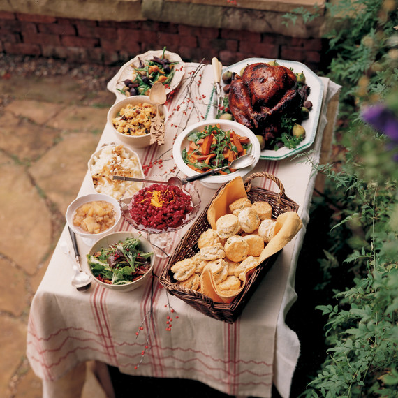 outdoor table with thanksgiving food on display