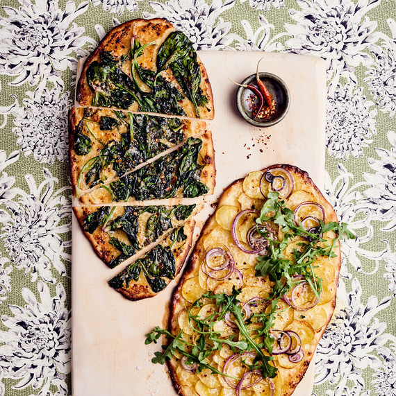 roman thin-crust pizzas with kale, arugula, and onion