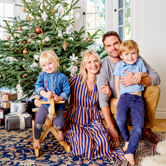 emily henderson posing with family and holiday decor