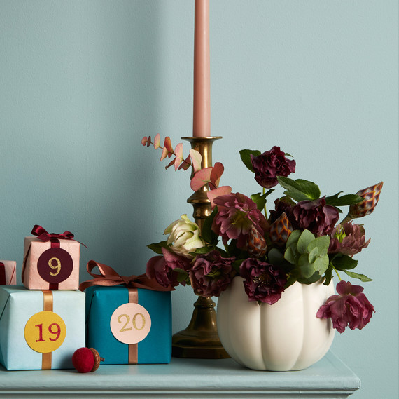 mantle blue wall flowers presents and candle details
