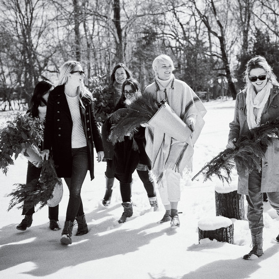 wreath making party guests carrying greenery