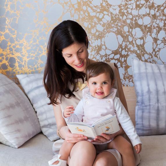 rachel cope portrait with baby on lap