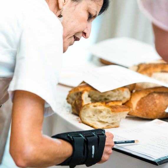 world bread awards usa judging woman scrutinizing entry