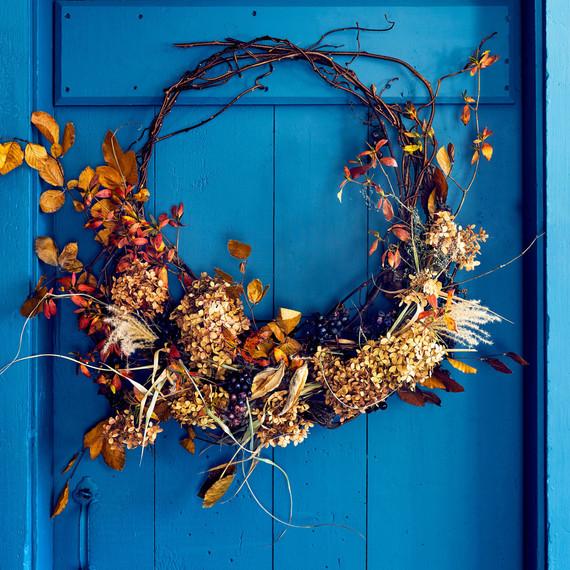 wreath hanging on blue door