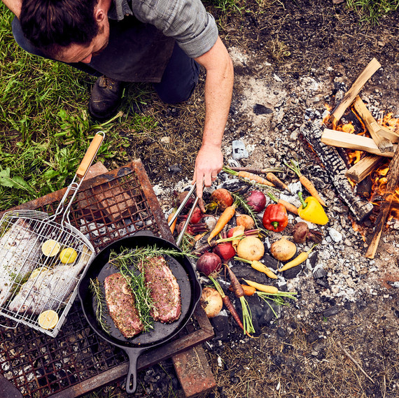 man outdoor fire cooking vegetables vermont makers 42 burners