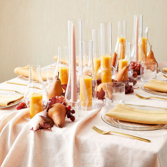 table settings candles centerpiece and linens in peach orange blush tones