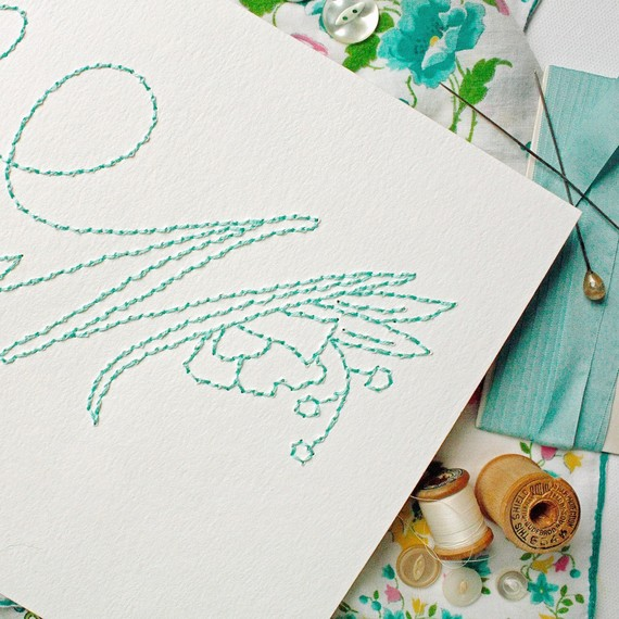 close-up of embroidered teal monogram