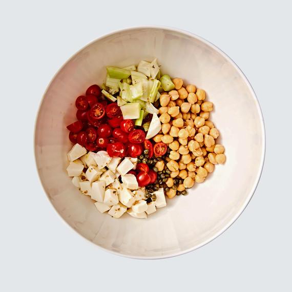 pasta salad ingredients in white bowl