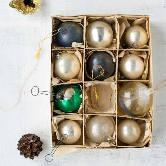 box of old glass christmas baubles gold green and gray