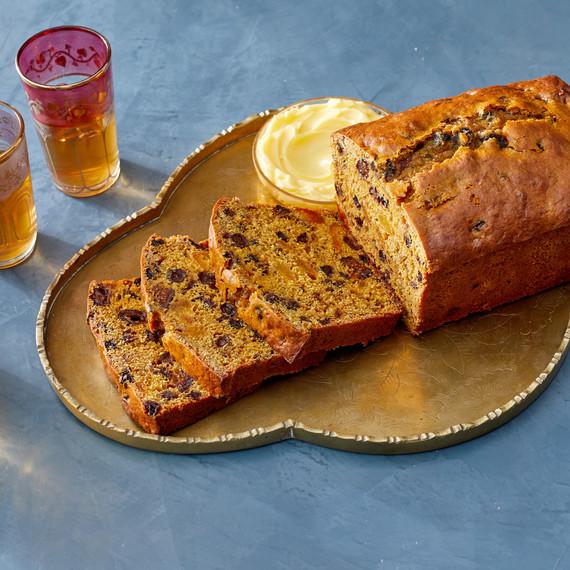 sliced fruit tea cake on golden platter