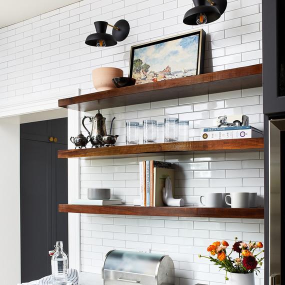 kitchen redo modern lighting over dark wooden floating shelves