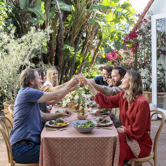 friends cheersing at an easter brunch table outside