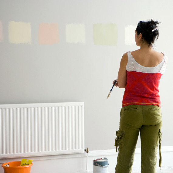 woman looking at various paint colors