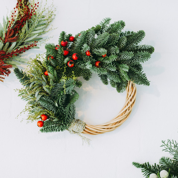 christmas wreath over white background with berries