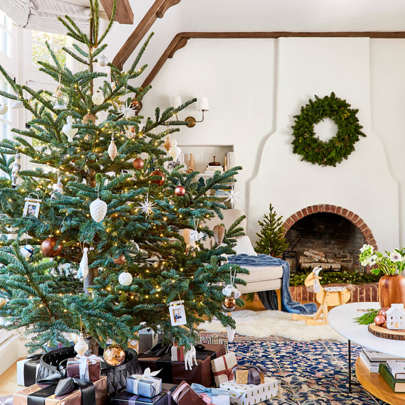 living room with christmas tree and presents emily henderson