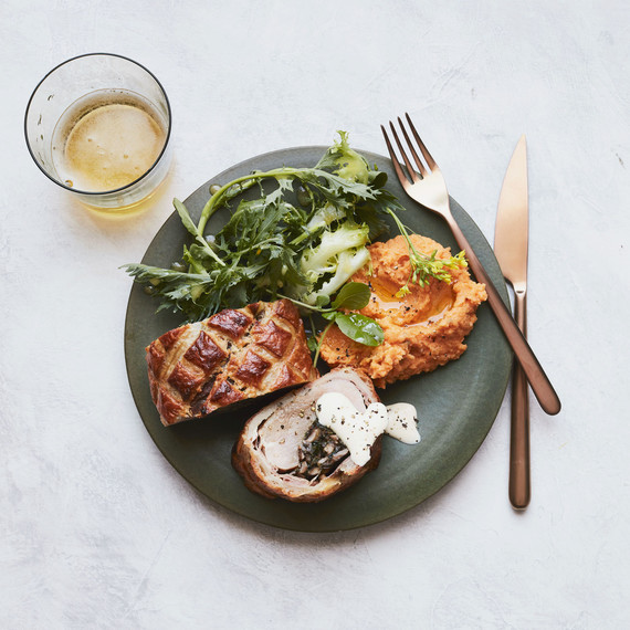 peppery greens with meyer lemon dressing and pork wellington