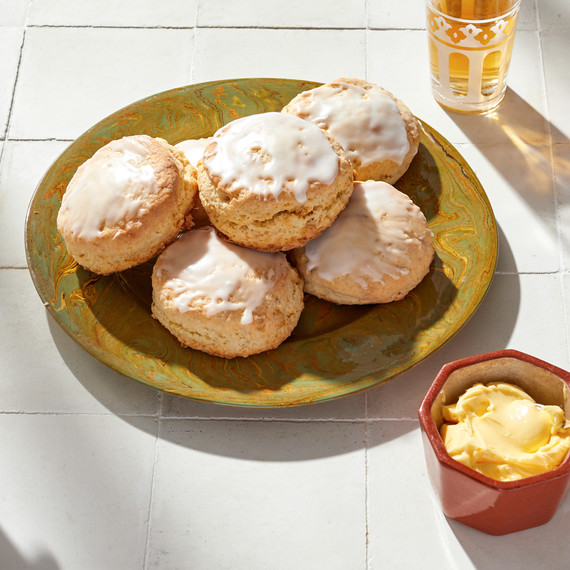 lemon ginger scones on plate next to butter dish