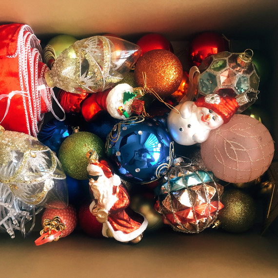 christmas ornaments in cardboard box
