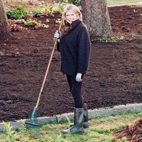 Martha holding a rake