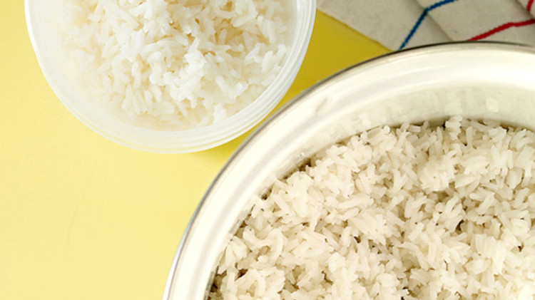 white rice in bowl yellow background