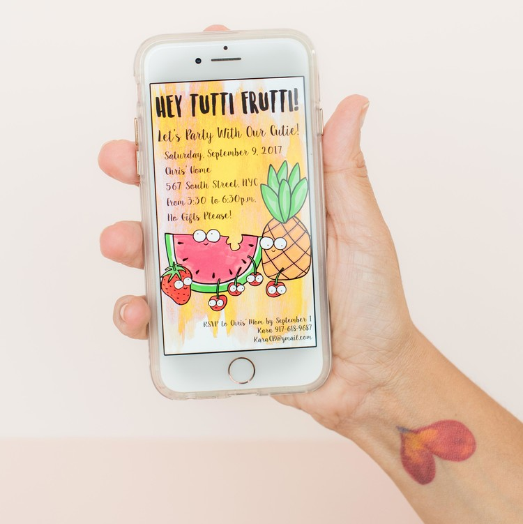tutti frutti party invite on phone