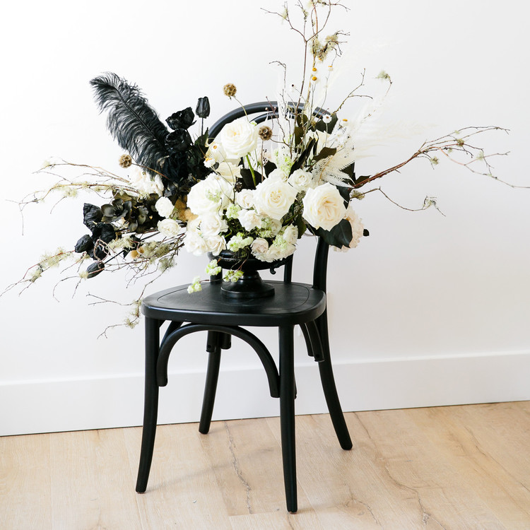 haunted movie house black chair with spooky flower arrangement decoartion