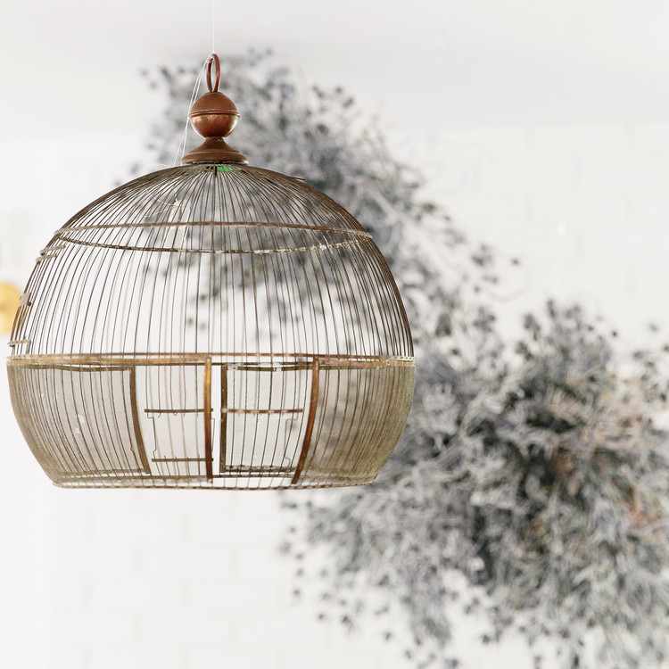 haunted movie house birdcage and white branches decor detail