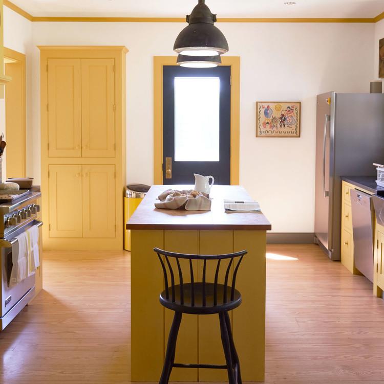 shaker stool in yellow kitchen