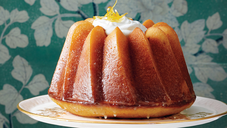 citrus bundt cake on cake stand