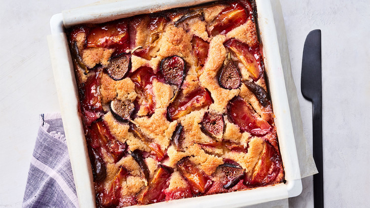 fig-and-plum cake served in a white dish