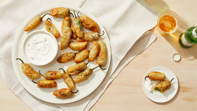 jalapeno poppers on plate with dip