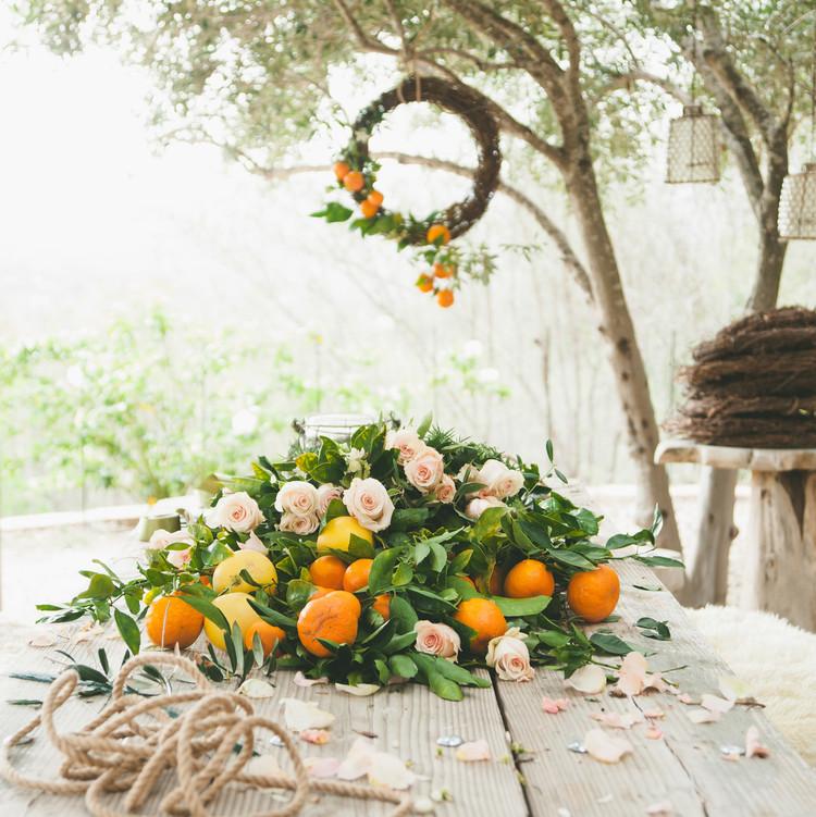 sweet laurel retreat table oranges wreath supplies