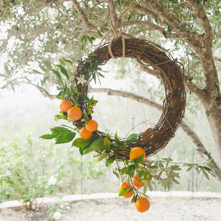 sweet laurel retreat hanging orange wreath